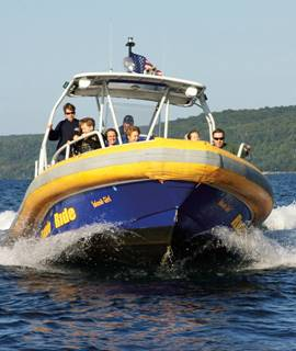Mackinaw city day trips riptide ride for Mackinaw city fishing charters